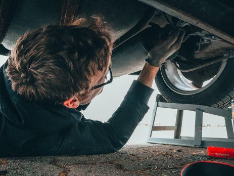 car mechanic working on car wearing disposable gloves